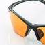 protective eyewear | photo of protective eyeglasses with an orange lens