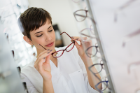 low price vs. high price glasses | photo of young woman shopping for glasses