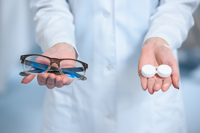 flexible spending account | photo of technician holding eyeglasses or contact lenses