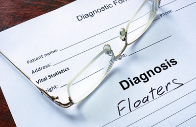 eye floaters | photo showing a prescription form reading: Diagnosis Floaters