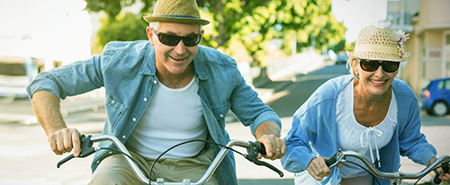 photo of a senior couple riding bikes
