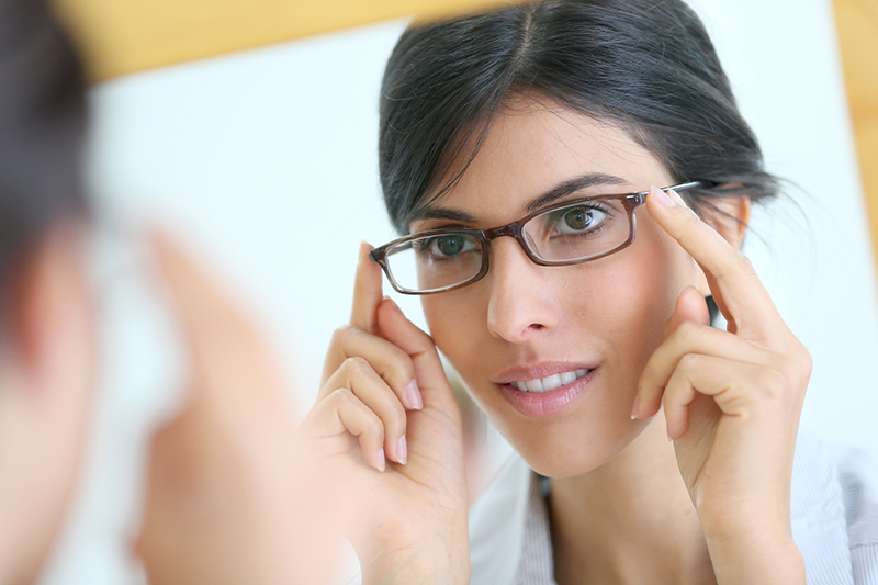 patient forms | photo of attractive woman trying on eyeglasses