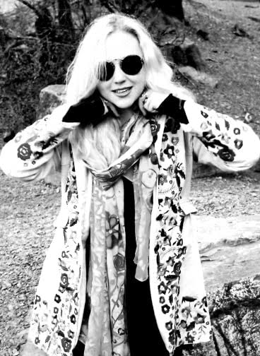 blank and white photo of blonde wearing designer sunglasses